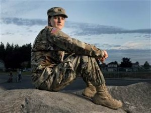 Capt. Jennifer Peace poses near her home in Spanaway, Wash., on Aug. 28, 2015. Peace is one of an estimated 15,000 transgender people who serve in the active-duty military. She's speaking out in the hopes of helping people understand transgender men and women. Drew Perine / The News Tribune via AP